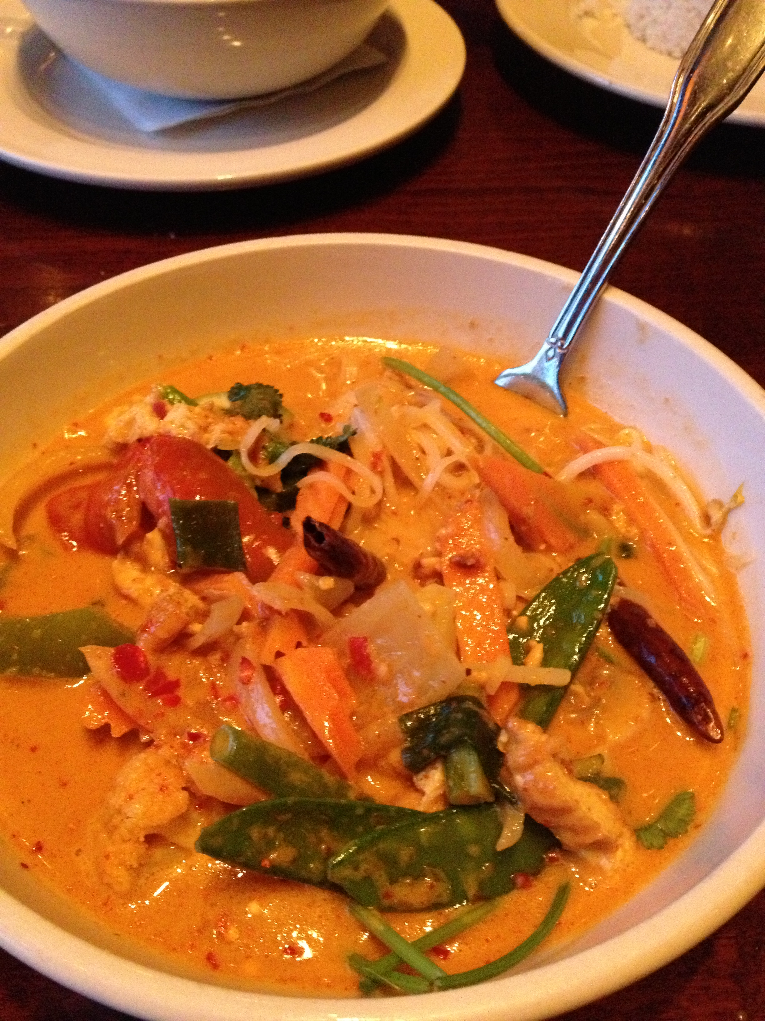 Mee Kah Teeh:  red curry sautéed with rice noodles, egg, peanuts, garlic, and bean sauce. Served with bean sprouts, fried chilies, scallions, cilantro and lime.